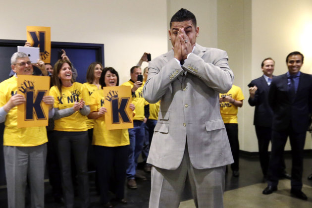 "Seattle Mariners' Felix Hernandez covers his face as he is greeted by front-office staff all wearing yellow ""Kings Court"" T-shirts before a news conference, Wednesday, Feb. 13, 2013, in Seattle. Herna"