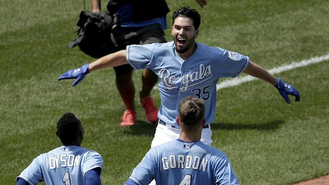 Kansas City Royals' Eric Hosmer (35) celebrates with teammates after hitting a double for the winning run in the ninth inning of a baseball game against the Minnesota Twins Sunday, July 5, 2015, in Kansas City, Mo. The Royals won the game 3-2. (AP Photo/Charlie Riedel)