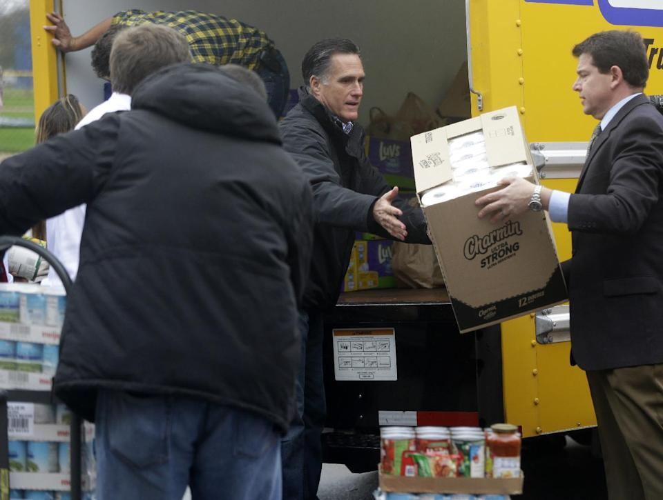Republican presidential candidate, former Massachusetts Gov. Mitt Romney loads a truck as he participates in a campaign event collecting supplies from local relief organizations for victims of superstorm Sandy, Tuesday, Oct. 30, 2012, at the James S. Trent Arena in Kettering, Ohio. (AP Photo/Charles Dharapak)