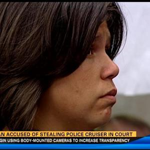 Woman accused of stealing police cruiser pleads not guilty
