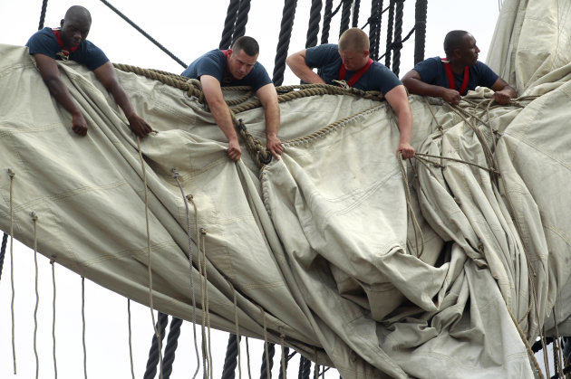 U.S. Navy personnel gather sails in the rigging of the USS Constitution as the vessel arrives at her berth in Charlestown Navy Yard, in Boston, Sunday, Aug. 19, 2012. The U.S. Navy's oldest commission