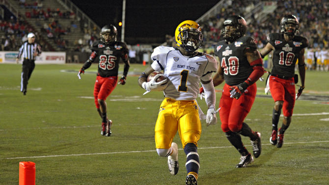 Kent State running back Dri Archer (1) crosses the goal line to score against Arkansas State in the second quarter of the GoDaddy.com Bowl NCAA college football game in Mobile, Ala., Sunday, Jan. 6, 2013. (AP Photo/G.M. Andrews)