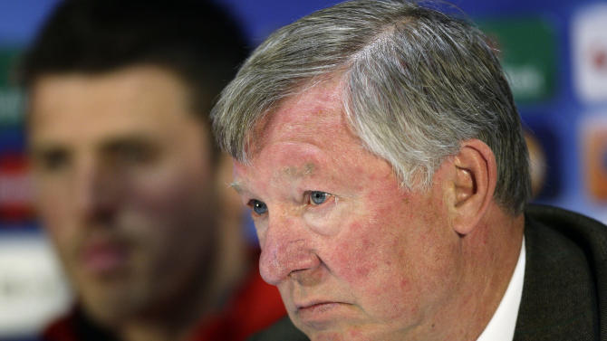 Manchester United's manager Sir Alex Ferguson, right, sits alongside Michael Carrick as he speaks at a press conference at Old Trafford Stadium in Manchester, Tuesday, May 3, 2011. Manchester United will play Schalke in a Champion's League semi-final second leg soccer match on Wednesday. (AP Photo/Jon Super)
