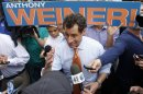 New York City mayoral hopeful Anthony Weiner discusses his policies with a passerby while greeting commuters during a campaign event outside a Harlem subway station, Thursday, May 23, 2013 in New York. Weiner, who ran for mayor in 2005 and nearly did in 2009, is getting into the race to succeed three-term Mayor Michael Bloomberg about two years after a series of tawdry tweets, and obfuscating explanations that capsized his promising congressional career. (AP Photo/Jason DeCrow)