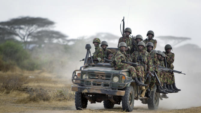 FILE - In this Monday, Feb. 20, 2012 file photo, Kenyan army soldiers ride in a vehicle at their base in Tabda, inside Somalia. Kenya's military said Friday, Sept. 28, 2012 that its troops attacked Kismayo, the last remaining port city held by al-Qaida-linked al-Shabab insurgents in Somalia, during an overnight attack involving a beach landing. (AP Photo/Ben Curtis, File)