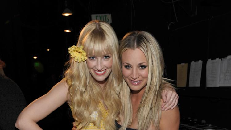 Actresses Beth Behrs, left, and Kaley Cuoco pose backstage at the 21st Annual 'A Night at Sardi's' to benefit the Alzheimer's Association at the Beverly Hilton Hotel on Wednesday, March 20, 2013 in Beverly Hills, Calif. (Photo by John Shearer/Invision for Alzheimer's Association/AP Images)