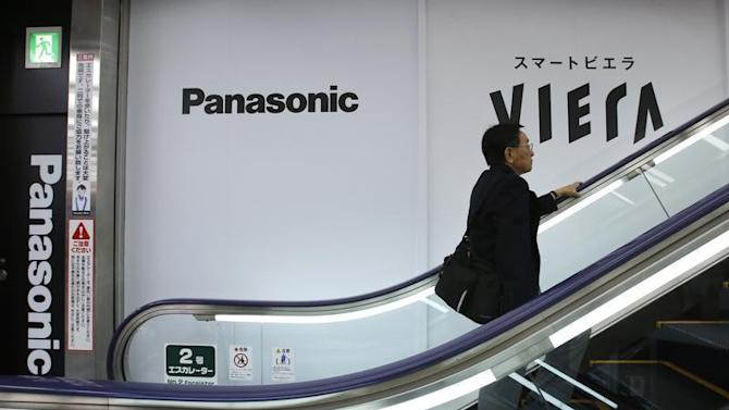 Panasonic Corp's logos are seen at an electronics store in Tokyo