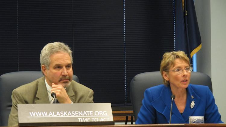 Sen. Cathy Giessel, R-Anchorage, answers a reporter's question during a news conference by members of the Senate majority on Tuesday, Feb. 19, 2013, in Juneau, Alaska. Next to Giessel is Sen. Pete Kelly, R-Fairbanks. (AP Photo/Becky Bohrer)