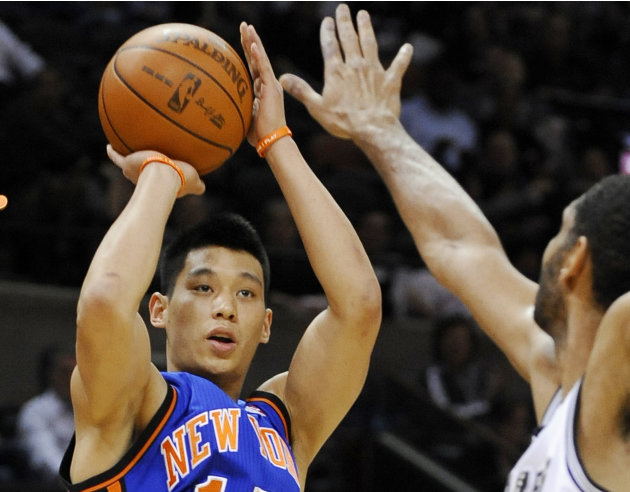 FILE - In this March 7, 2012 file photo, New York Knicks' Jeremy Lin, left, shoots over San Antonio Spurs' Tim Duncan during the first half of an NBA basketball game, in San Antonio. This would have b