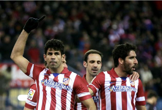 Atletico Madrid's Diego Costa celebrates his penalty goal against Levante with teammates during their Spanish first division soccer match in Madrid