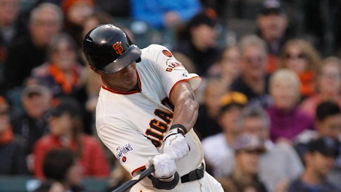 San Francisco Giants' Justin Maxwell hits an RBI single during the second inning of a baseball game against the San Diego Padres, Tuesday, May 5, 2015, in San Francisco. (AP Photo/Mathew Sumner)