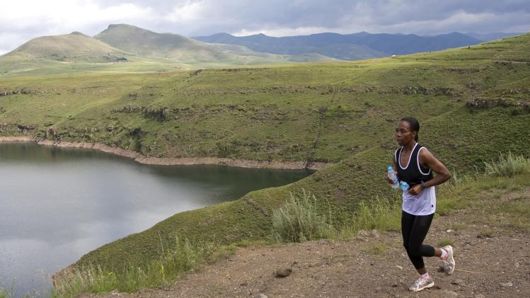 A runner takes part in the Highlands Trout Mountain Challenge near the Katse Dam in the rugged southern African kingdom of Lesotho