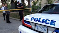 A police officer works near the scene of a fatal shooting in Scarborough on Friday.
