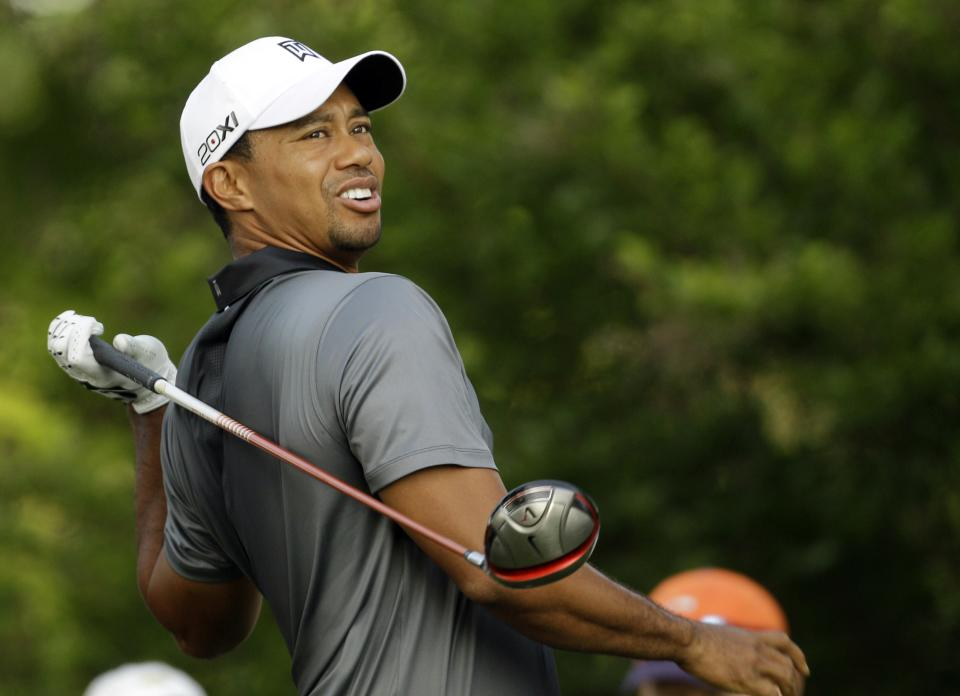 Tiger Woods reacts after hitting his tee shot on the third hole during the pro-am of the Wells Fargo Championship golf tournament at Quail Hollow Club in Charlotte, N.C., Wednesday, May 2, 2012. (AP Photo/Chuck Burton)
