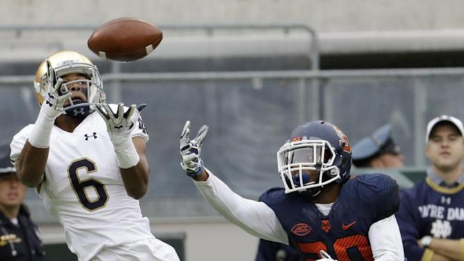 Notre Dame wide receiver Equanimeous St. Brown (6) catches a touchdown pass as Syracuse defensive back Cordell Hudson (20) defends during the first half of an NCAA college football game, Saturday, Oct. 1, 2016, at MetLife Stadium in East Rutherford, N.J. (AP Photo/Julio Cortez)