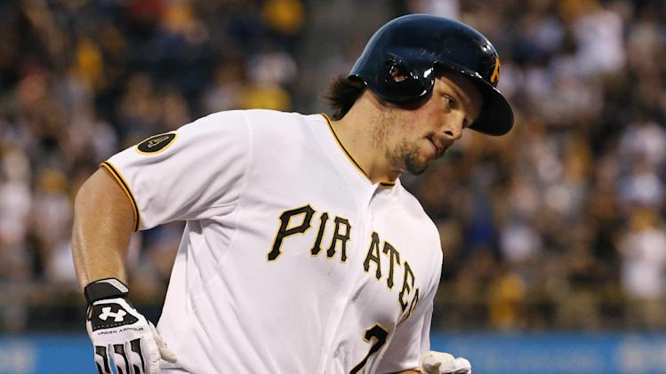 Pittsburgh Pirates' Travis Snider rounds third after hitting a solo home run off Los Angeles Dodgers starting pitcher Dan Haren during the second inning of a baseball game in Pittsburgh, Wednesday, July 23, 2014. (AP Photo)