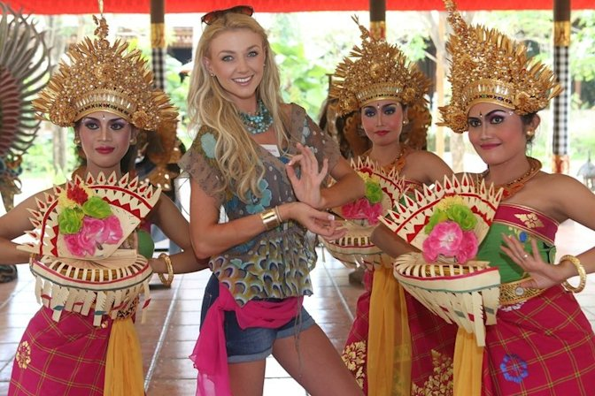 Miss Ireland, Aoife Walsh, poses with Balinese dancers in Bali, Indonesia on September 12, 2013