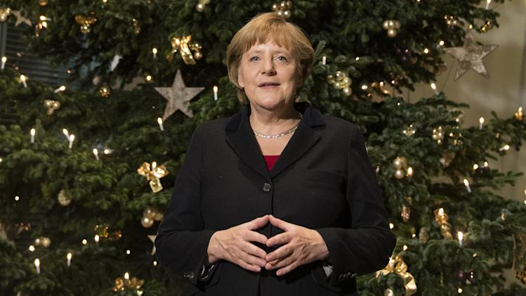 German chancellor Angela Merkel stands in front of a huge Christmas  Tree, she just received,  in the chancellery in Berlin, Thursday Nov. 29, 2012.  (AP Photo/dapd/ Clemens Bilan)