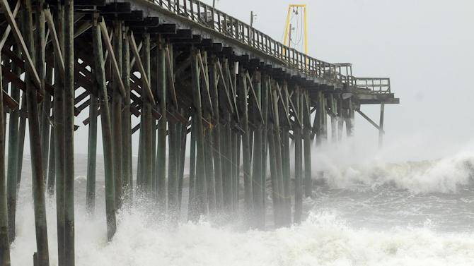 Waves pound Carolina Beach pier in Carolina Beach, N.C., Saturday, Oct 27, 2012 as Hurricane Sandy churns in the Atlantic Ocean. Hurricane Sandy, upgraded again Saturday just hours after forecasters said it had weakened to a tropical storm, was barreling north from the Caribbean and was expected to make landfall early Tuesday near the Delaware coast, then hit two winter weather systems as it moves inland, creating a hybrid monster storm. (AP Photo/The Star-News, Ken Blevins)