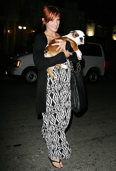 Simpson Ashlee Holding Dog