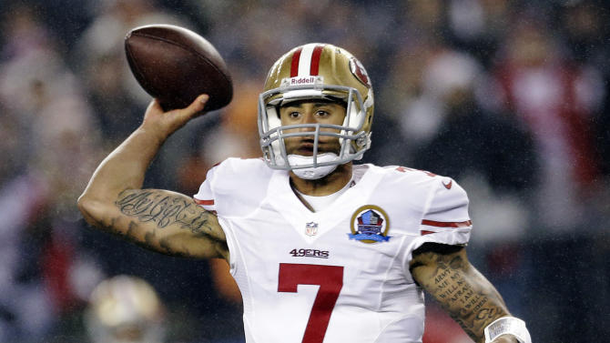 San Francisco 49ers quarterback Colin Kaepernick (7) passes against the New England Patriots in the first quarter of an NFL football game in Foxborough, Mass., Sunday, Dec. 16, 2012. (AP Photo/Elise Amendola)