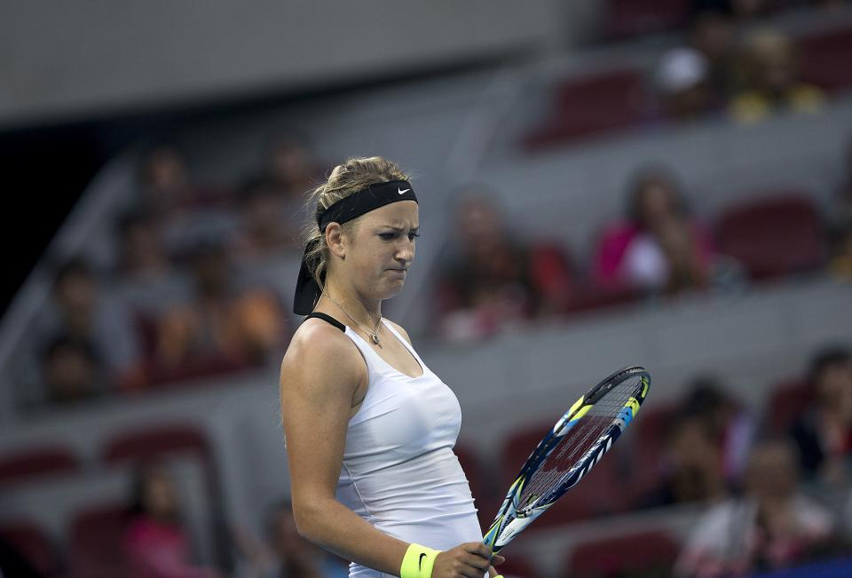 Belarus' Victoria Azarenka looks at her racquet during the women's singles semifinal match against Marion Bartoli of France in the China Open tennis tournament in Beijing Saturday, Oct. 6, 2012. Azarenka defeated Bartoli 6-4, 6-2. (AP Photo/Andy Wong)