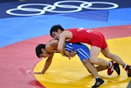 North Korea's Yang Kyong Il (R) fights Kazakhstan's Daulet Niyazbekov during their men's 55kg freestyle bronze medal match at the London 2012 Olympic Games on August 10, 2012. Wrestling, an Olympic sport since the first Games in ancient Greece, looks set to be dropped for the 2020 edition, after the International Olympic Committee voted on Tuesday to remove it from the programme