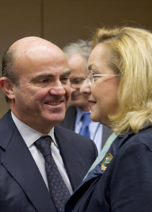 Austria's Finance Minister Maria Fekter, right, speaks with Spain's Economy Minister Luis de Guindos during a meeting of EU finance ministers in Brussels on Wednesday, Dec. 12, 2012. European Union fi