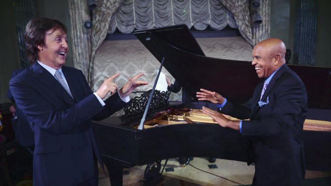 """FILE - In this Sept. 18, 2012 file photo provided by the Motown Museum, Paul McCartney, left, and Berry Gordy stand in front of a newly restored 1877 Steinway grand piano during a benefit at the Motown Museum at Steinway Hall in New York. The piano, used by Motown greats during the label's heyday, was restored with an assist by McCartney. In an April 1, 2013 news release from the museum, it was announced that the famed 9-foot piano has been returned to Detroit and will go back on display at the Motown museum's famed Studio A in the """"Hitsville, U.S.A.,"""" building. (AP Photo/Motown Museum, Shahar Azran, File) MANDATORY CREDIT"""