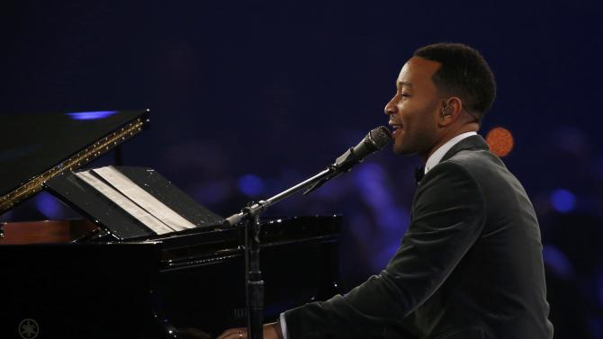 "Musician John Legend performs ""Easy"" at the 2016 MusiCares Person of the Year gala in Los Angeles"
