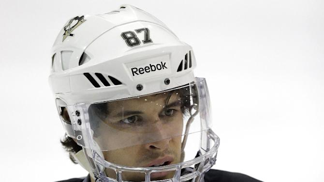Pittsburgh Penguins' Sidney Crosby participates NHL hockey practice in Canonsburg, Pa., Tuesday, April 30, 2013. The Penguins take on the New York Islanders in the first round of the NHL hockey playoffs on Wednesday, May 1, in Pittsburgh. Crosby hasn't played since breaking his jaw a month ago. (AP Photo/Gene J. Puskar)