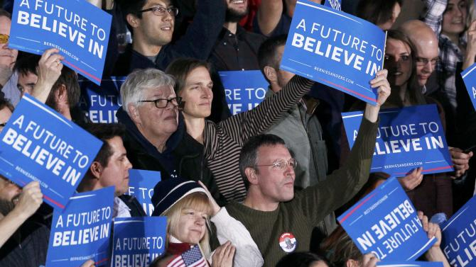 Supporters of Democratic U.S. presidential candidate Bernie Sanders, react as CNN projects a win for Sanders in Concord