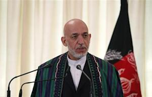 Afghan President Karzai speaks during a joint news conference in Islamabad