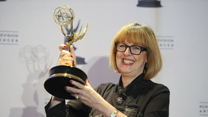 """Gemma Jackson poses backstage with her award for outstanding art direction for a single-camera series for """"Game of Thrones"""" at the 2012 Creative Arts Emmys at the Nokia Theatre on Saturday, Sept. 15, 2012, in Los Angeles. (Photo by Chris Pizzello/Invision/AP)"""