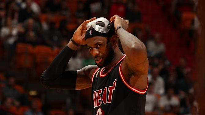 James helps Heat beat Magic 112-98