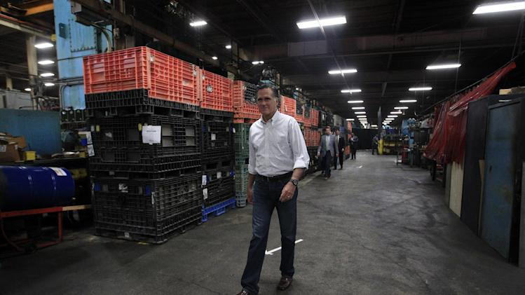 Republican presidential candidate, former Massachusetts Gov. Mitt Romney walks along the arrow marks as he arrives for a town hall-style meeting at Stamco Industries, Inc., in Euclid, Ohio, Monday, May 7, 2012. (AP Photo/Jae C. Hong)