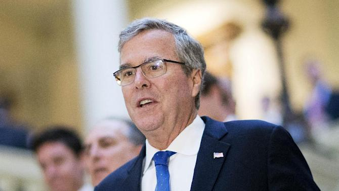 FILE - In this March 19, 2015 file photo, former Florida Gov. Jeb Bush visits the Georgia Capitol in Atlanta. In the Republican roar over Common Core, various myths are being peddled as fact. Even so, the 2016 GOP presidential prospects who are criticizing Common Core have a point _ if an overstated one _ when they dispute the notion that it is strictly a voluntary initiative that bubbled up from communities and states.  In complicated but unmistakable ways, the federal government does put pressure on states to live up to the standards. (AP Photo/David Goldman, File)
