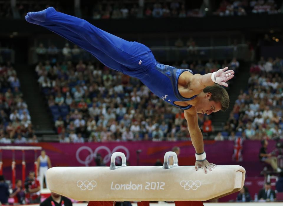 U.S. gymnast Samuel Mikulak performs on the pommel horse during the Artistic Gymnastics men's qualification at the 2012 Summer Olympics, Saturday, July 28, 2012, in London. (AP Photo/Matt Dunham)