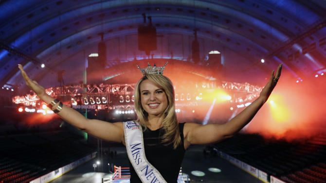 Miss New Jersey for 2012 in the Miss America pageant, Lindsey Petrosh, of Egg Harbor City, N.J., gestures for photographs in Atlantic City's Boardwalk Hall, Thursday, Feb. 14, 2013, in Atlantic City, after New Jersey Lt. Gov. Kim Guadagno announced that the Miss America pageant is returning to Atlantic City. The pageant returns to Atlantic City in September after spending six years in Las Vegas. (AP Photo/Mel Evans)