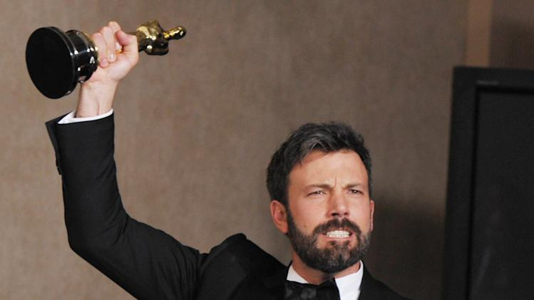 "Ben Affleck poses with his award for best picture for ""Argo"" during at the Oscars at the Dolby Theatre on Sunday Feb. 24, 2013, in Los Angeles. (Photo by John Shearer/Invision/AP)"