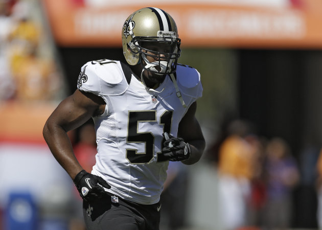 New Orleans Saints linebacker Jonathan Vilma runs off the field after the coin flip before an NFL football game against the Tampa Bay Buccaneers Sunday, Oct. 21, 2012, in Tampa, Fla. (AP Photo/Chris O&#39;Meara)