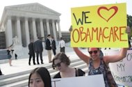 "Demonstrators in favor of US President Barack Obama's signature healthcare legislation await a decision by the US Supreme Court on the constitutionality of the Affordable Healthcare Act, outside the Supreme Court in Washington, DC, June 28. Obama claimed a ""victory"" for all Americans after the Supreme Court upheld his reforms to extend health insurance to another 32 million citizens"