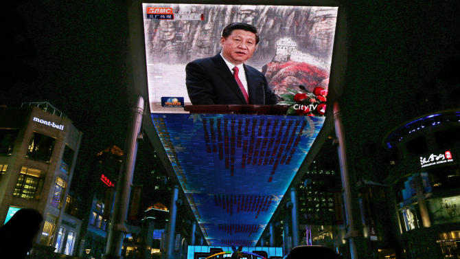 China's Xi warns party of corruption scourge