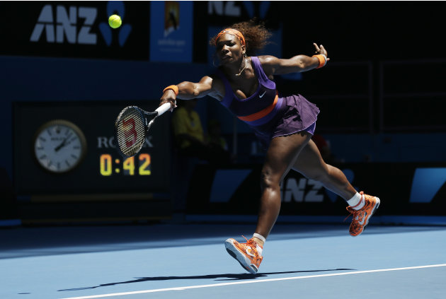 Serena Williams of the US stretches for  forehand return to mRomania's Edina Gallovits-Hall during their first round match at the Australian Open tennis championship in Melbourne, Australia, Tuesday,
