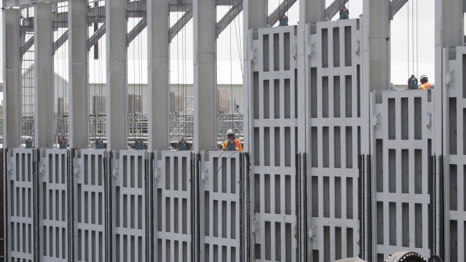 FILE - In this May 27, 2009 file photo, Water is pumped through giant outflow tubes around the floodgate at the London Ave. outflow canal by the Army Corps of Engineers during a test in New Orleans. By the time the next hurricane season starts in June 2013, New Orleans will control much of a revamped protection system of gates, walls and armored levees the Army Corps of Engineers has spent about $12 billion building. The corps has about $1 billion worth of work left. Engineers consider it a Rolls Royce of flood protection _ comparable to systems in seaside European cities such as Venice and Rotterdam. Whether the infrastructure can hold is less in question than whether New Orleans can be trusted with the keys. (AP Photo/Bill Haber, File)