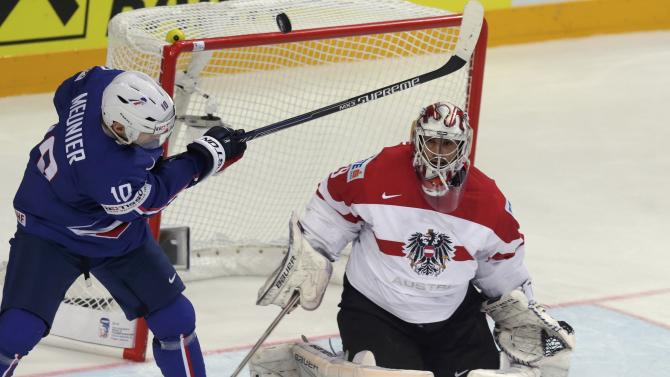 France's Meunier tries to score past Austria's goaltender Strakbaum during their Ice Hockey World Championship game at the O2 arena in Prague
