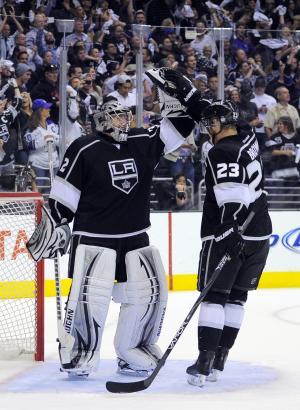 Los Angeles Kings goalie Jonathan Quick, left, celebrates with Dustin Brown after the Kings scored an empty-net goal against the St. Louis Blues during the third period in Game 4 of an NHL hockey Stanley Cup second-round playoff series, Sunday, May 6, 2012, in Los Angeles. The Kings won 3-1 to win the series 4-0. (AP Photo/Mark J. Terrill)