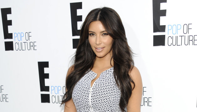 FILE - In this April 30, 2012 file photo, Kim Kardashian from the show &quot;Keeping Up With The Kardashians&quot; attends an E! Network upfront event at Gotham Hall in New York. Kardashian&#39;s lawsuit against Old Navy over an advertisement was dismissed Tuesday Aug. 28, 2012 after the two sides reached a settlement. Kardashian sued the retailer last year, claiming they violated her publicity rights by using a lookalike in an ad. (AP Photo/Evan Agostini, File)