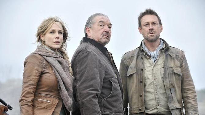 """This publicity image released by Syfy shows Julie Benz as Amanda Rosewater, left, Graham Greene as Rafe McCawley, and Grant Bowler as Jeb Nolan, right, in a scene from the  series, """"Defiance,"""" premiering Monday, April 15, 2013 at 9 p.m. EST on Syfy. (AP Photo/Syfy,  Ben Mark Holzberg)"""