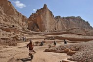 Labourers work at an archaeological site in Bamiyan. Below ground, the relics are protected from endemic looting, illegal smuggling and the corrosive effects of freezing winters
